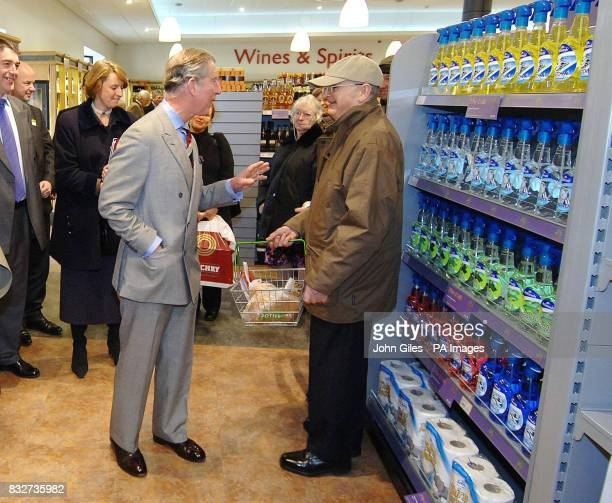 The Prince of Wales talks to a customer during a visit to a supermarket in Keswick Cumbria which is committed to local sourcing of produce meeting...
