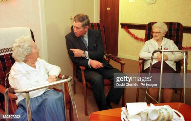 The Prince of Wales talks to Agnes Penglase and Mary Conn both 100yearsold during his visit to the Crossmyloof Resource Centre for older people in...