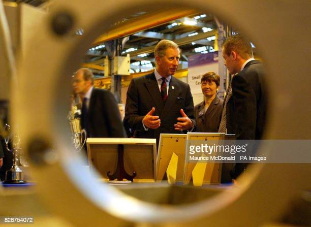 The Prince of Wales talks to apprentice Andrew Wallace at the Weir Pumps in Cathcart Glasgowwhere he visited workers at Scotland's largest...