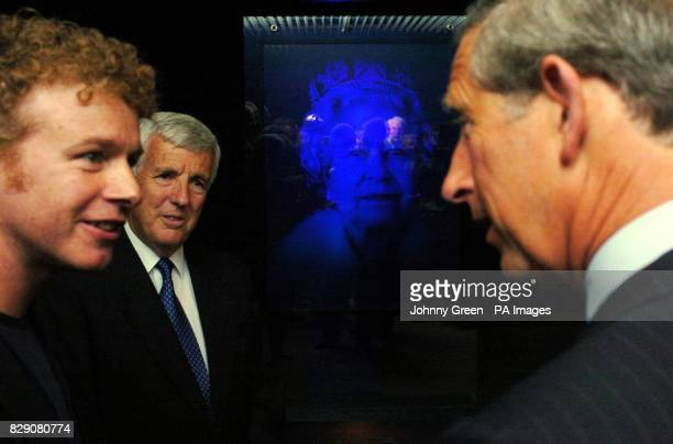 The Prince of Wales talks to artist Chris Levine as the Chairman of Jersey Heritage Trust Jurat John de Veuille looks on after Prince Charles had...