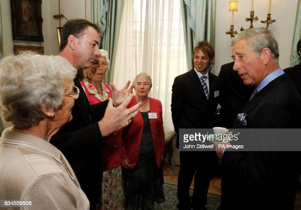 The Prince of Wales talks to community volunteer worker Sheila Baldwin from Eastbourne in Dorset during a reception for the Hope 08 initiative at...