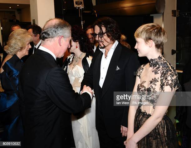 The Prince of Wales talks to Johnny Depp and Mia Wasikowska on arriving for the Royal world premiere of Alice in Wonderland at the Odeon Leicester...