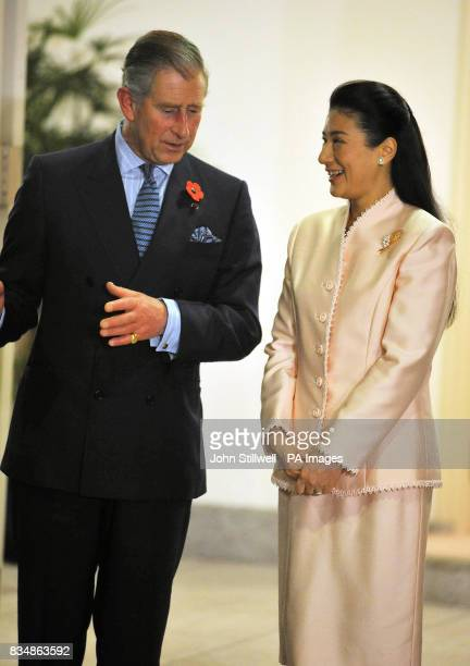 The Prince of Wales talks to the Japanese Crown Prince Naruhito's wife Masako at their Imperial Palace residence in Tokyo