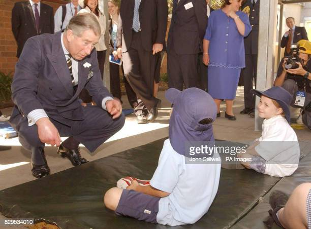 The Prince of Wales talks with children from Coburg North primary school in the suburbs of Melbourne Charles also visited Geelong Grammar School...