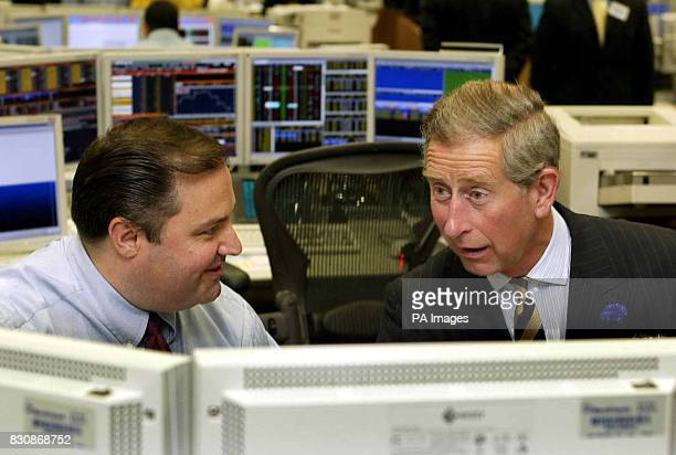 The Prince of Wales talks with equities trader Grant Turner during a visit to the trading floors of the Merrill Lynch Financial Centre in the City