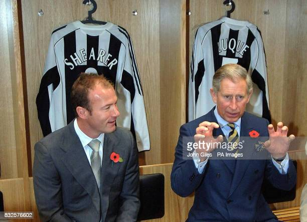 The Prince of Wales talks with exNewcastle United player Alan Shearer in the changing room during a visit to the club's St James' Park ground