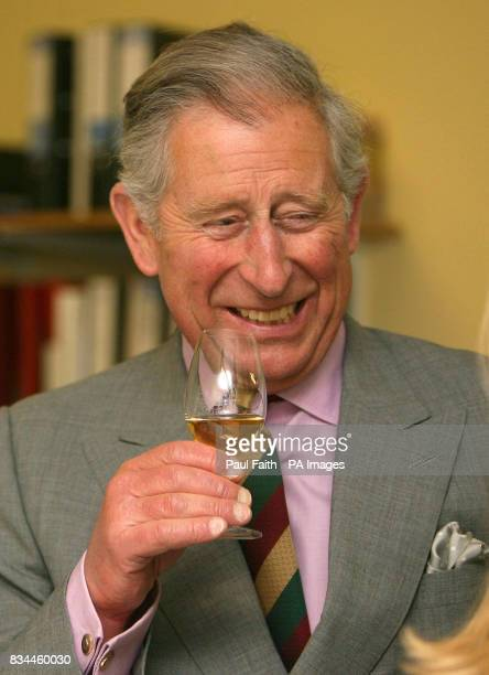 The Prince of Wales tries some Bushmills whiskey on a visit to the Distillery in Co Antrim Northern Ireland
