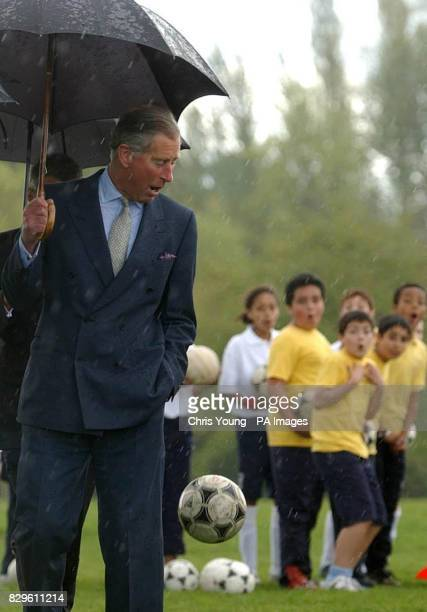 The Prince of Wales turns after being struck by a football The north London schoolboy's misplaced kick of a football stuck the heir to the throne...