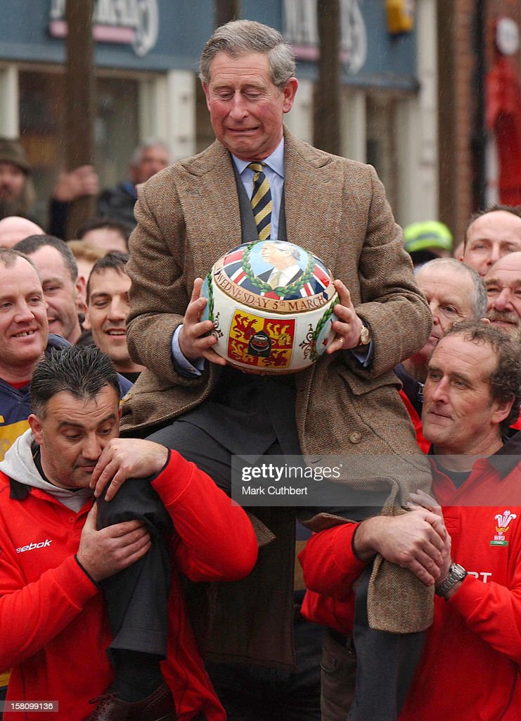 The Prince Of Wales 'Turns The Ball' At The Annual Shrovetide Football Match In Ashbourne, Derbyshire. .
