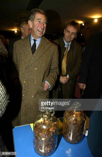 The Prince of Wales visits local traders takes a 10p guess on the amount of coins in a pair of jugs at the local Lions Club stall and switches on the...