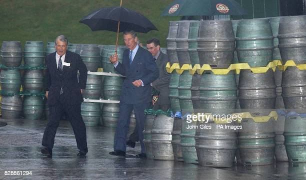 The Prince of Wales walks across the brewery yard during a visit to the JW Lees Brewery at Middleton near Manchester Members of the LeesJones family...