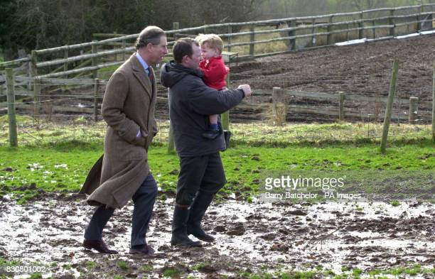 The Prince of Wales walks along a muddy path during a visit to the Cantref Riding Centre in the Brecon Beacons midWales Braving muddy fields in his...