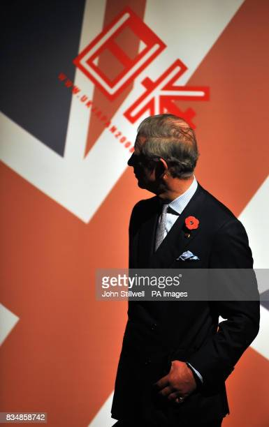 The Prince of Wales watches an audiovisual of the effects of global warming during his tour of the Museum of Science and Innovation in central Tokyo...