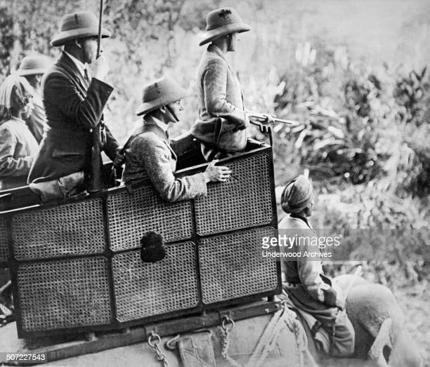 The Prince of Wales watches from his howdah atop an elephant for any big game to break cover while on his hunting expedition in the jungles of Nepal...