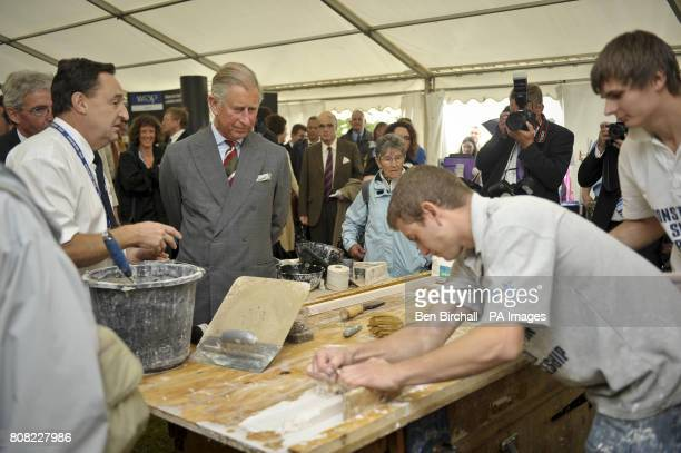 The Prince of Wales watches traditional crafts in a tent at the National Botanic Gardens of Wales in Carmarthen as he continues his tour of Britain...