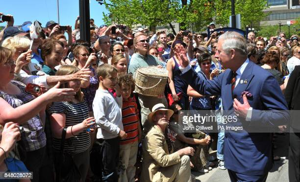 The Prince of Wales waves to well wishers during a walk down Prince William road in Saint John eastern Canada on the second day of a four day Diamond...