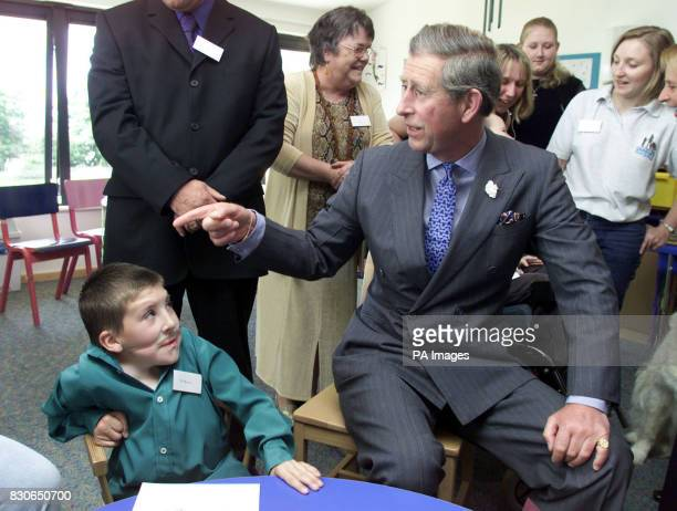 The Prince of Wales wearing a white friendship bracelet as he chats to resident Adam Leighton at the Ty Hafan Children's Hospice Sully South Wales...