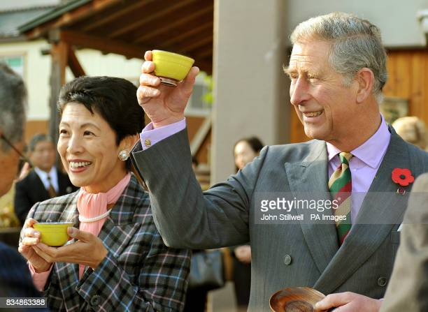 The Prince of Wales with Japanese Princess Takamado raises his cup of tea in toast to the locals of Shinanomachi village in central Japan
