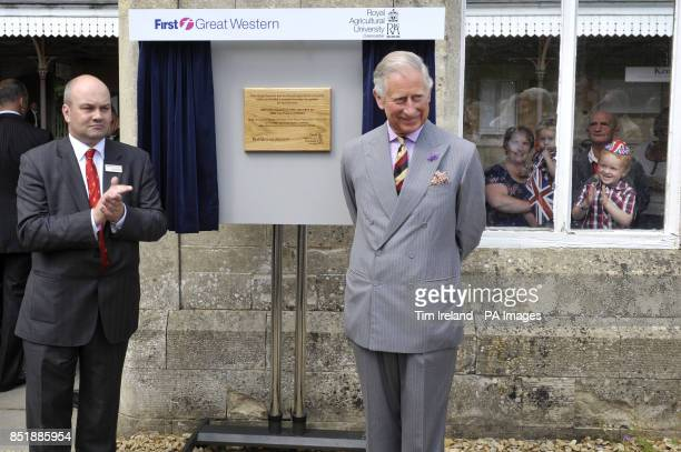 The Prince of Wales with MD of First Great Western Mark Hopwood unveils a plaque in the garden during a visit to Kemble train station in...