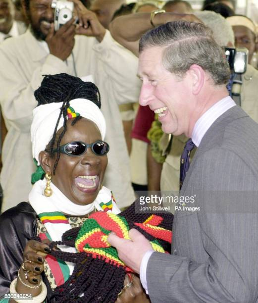 The Prince of Wales with reggae legend Bob Marley's widow Rita asks the waiting media to wait one second as he prepares to wear a Rasta hat at the...