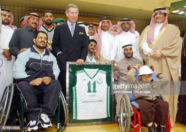 The Prince of Wales with the Prince Sultan of Saudi Arabia stands with the signed shirt that was presented to him at the Saudi Sports Federation for...