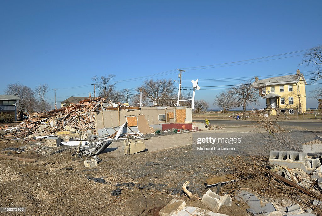 The Princess Cottage Inn (R) stands across the street from a onetime residence, now a vacant lot of wreckage on December 14, 2012 in Union Beach, New Jersey. The town is struggling to rebuild and recover from the devastation left by Superstorm Sandy and relying heavily on donations.