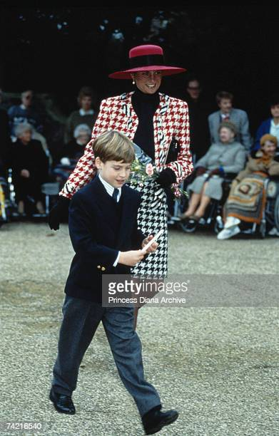 The Princess of Wales and her son Prince William attend the christening of Princess Eugenie at Sandringham Church 23rd December 1990 Diana is wearing...