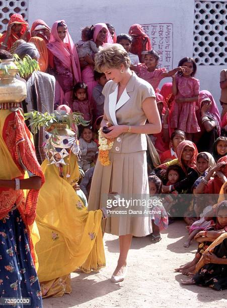 The Princess of Wales and local women during a visit to Malu village Rajastan India February 1992 Diana is wearing a dress by Catherine Walker