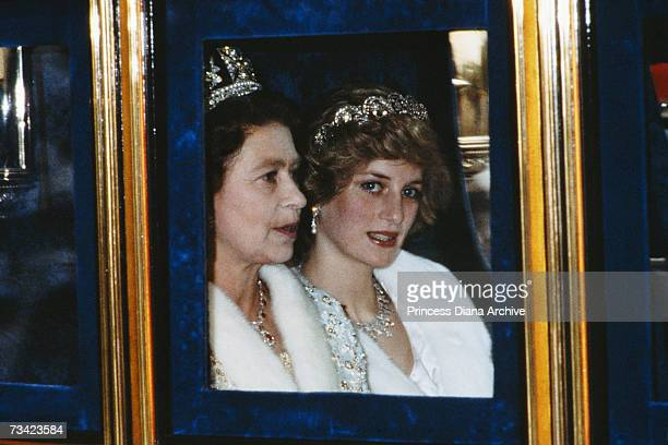 The Princess of Wales and the Queen attend the Opening of Parliament in London November 1982 Diana is wearing a white fur coat and the Spencer tiara