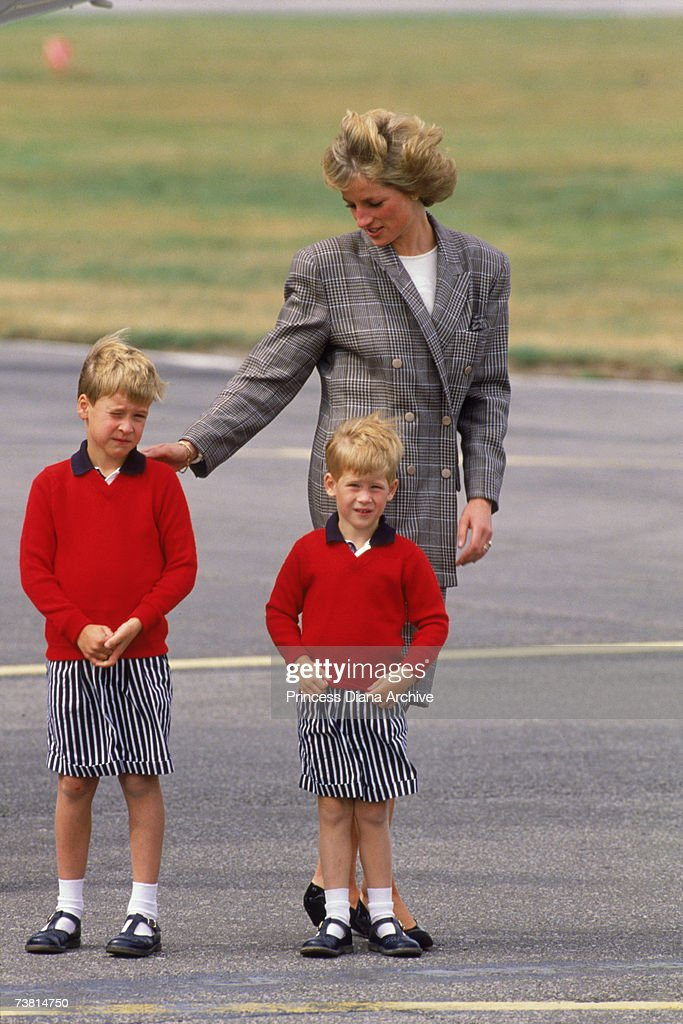 The Princess of Wales (1961 - 1997) arrives at Aberdeen airport with her sons William and Harry, 14th August 1989. She is wearing a Mardi suit.