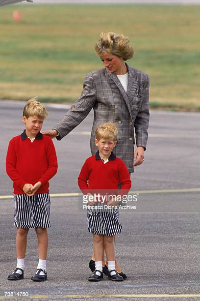 The Princess of Wales arrives at Aberdeen airport with her sons William and Harry 14th August 1989 She is wearing a Mardi suit