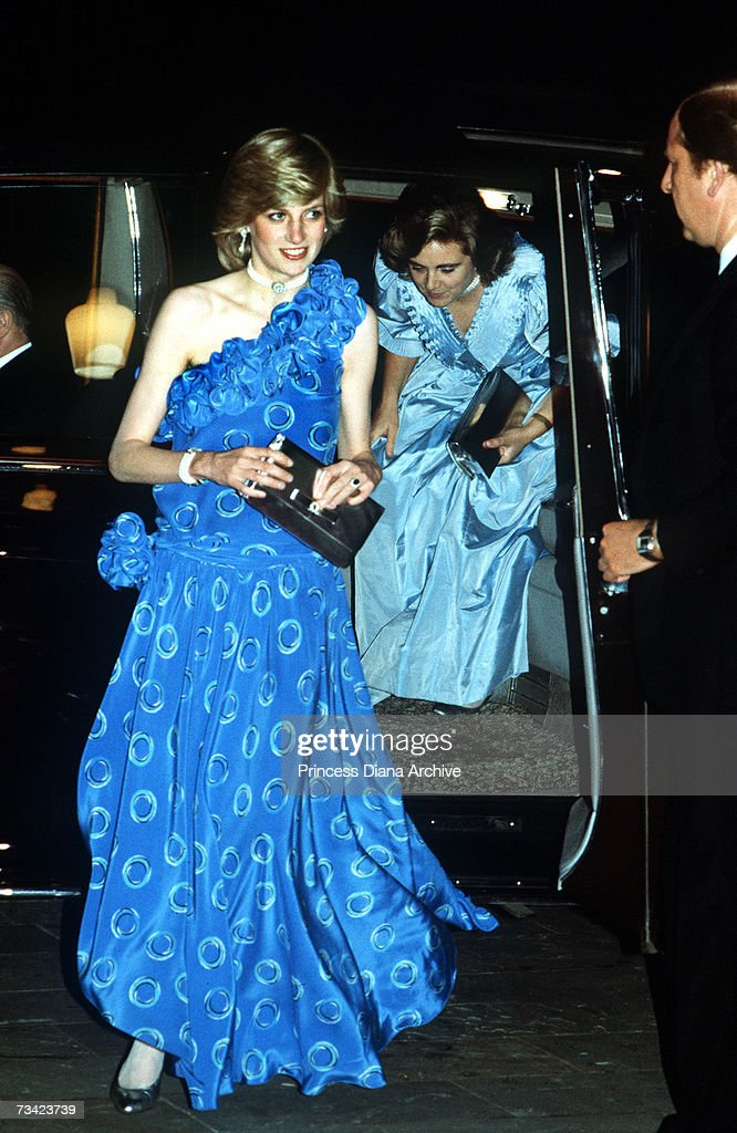 The Princess of Wales arrives at the Guildhall in London for a fashion show, November 1982. She is wearing a blue dress by Bruce Oldfield. She is accompanied by her lady-in-waiting Anne Beckwith-Smith.