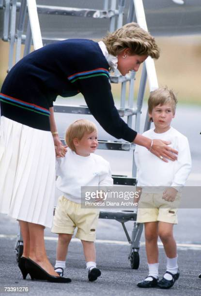 The Princess of Wales arriving at Aberdeen airport with her sons William and Harry for a holiday at Balmoral Castle August 1986 Princess Diana is...