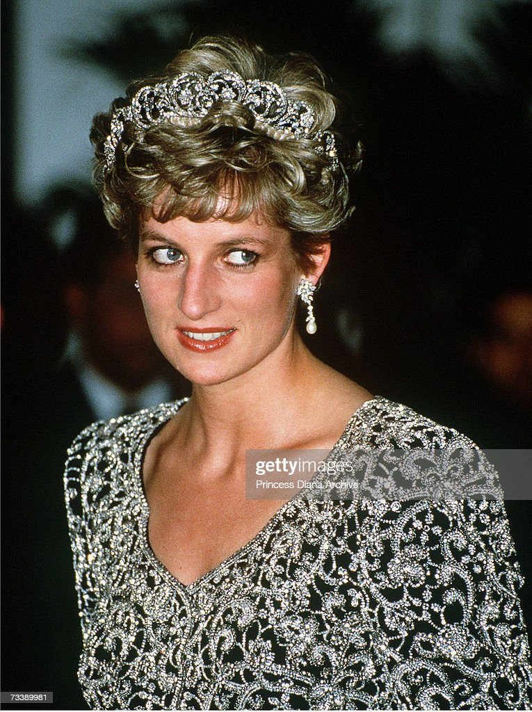 The Princess of Wales attending a banquet given by the President of India, Ramaswamy Venkataraman, during an official visit to the country, February 1992. She is wearing the Spencer family tiara and a gown by Catherine Walker.