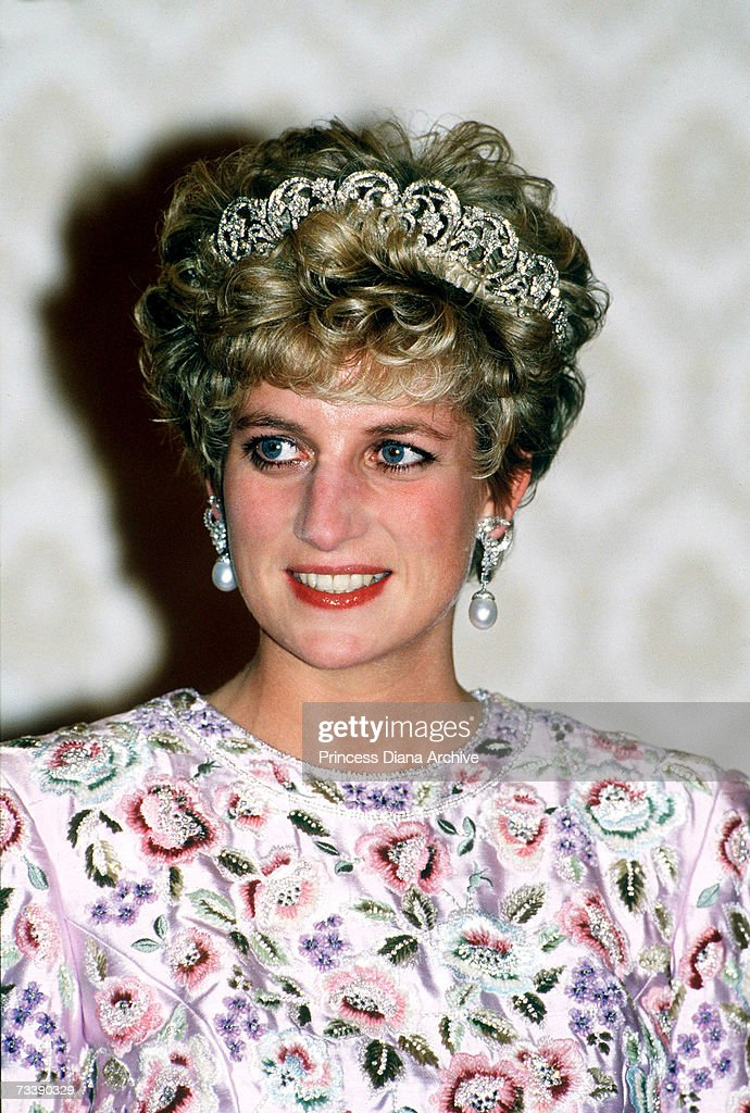 The Princess of Wales attending a banquet thrown by President Roh in Seoul, South Korea, November 1992. Diana wears the Spencer family tiara and a gown by Catherine Walker.