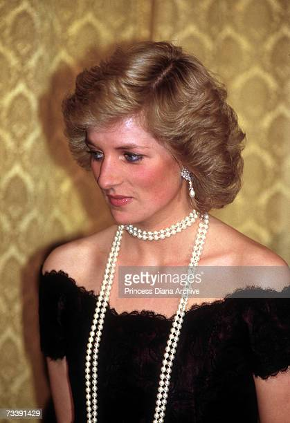 The Princess of Wales attending a dinner in Hamburg Germany November 1987 She is wearing a Victor Edelstein gown and a long string of pearls