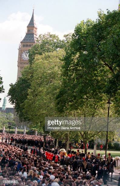 The Princess of Wales' coffin escorted by Coldstream Guards passing Big Ben on the way to Westminster Abbey for her funeral service 6th September 1997