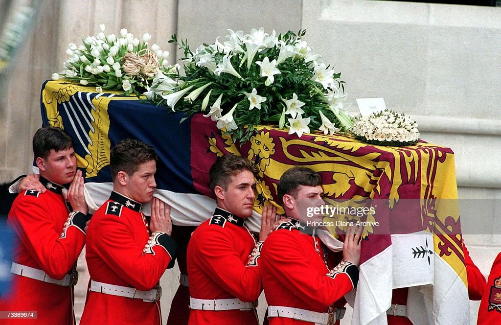 The Princess of Wales' coffin is carried from Westminster Abbey after the funeral service, 6th September 1997. The card on the top is from Princes William and Harry and addressed to 'mummy'.