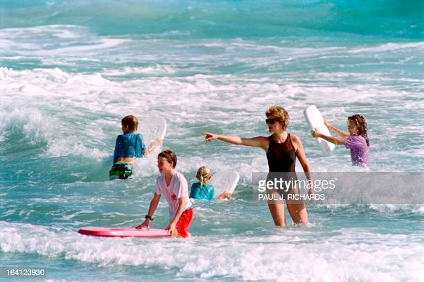 The Princess of Wales heads out into the surf as her sons William and Harry enjoy the waters of Indian Castle Beach on January 1 1993 during vacation...