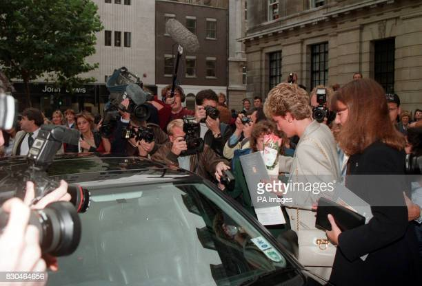 The Princess of Wales is mobbed by photographers and wellwishers as she leaves the Royal College of Nursing in London's Cavendish Square with her...