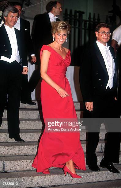 The Princess of Wales leaves a gala dinner in Washington DC wearing a red Victor Edelstein dress October 1990