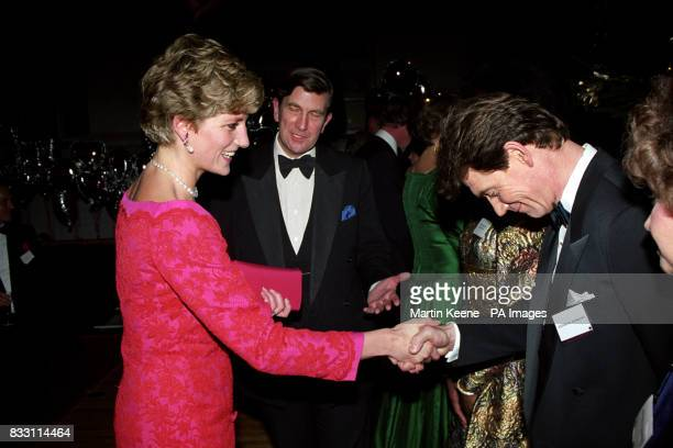 The Princess of Wales meets Anthony Andrews at the London's Royal School of Music after she and her two sons Prince William and Prince Harry attended...