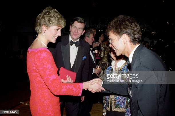 The Princess of Wales meets Cliff Richard at the London's Royal School of Music after she and her two sons Prince William and Prince Harry attended...