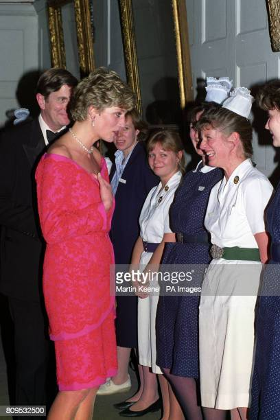 The Princess of Wales meets nurses radiographers and a dietitian from the Royal Marsden Hospital at London's Royal School of Music after she and her...