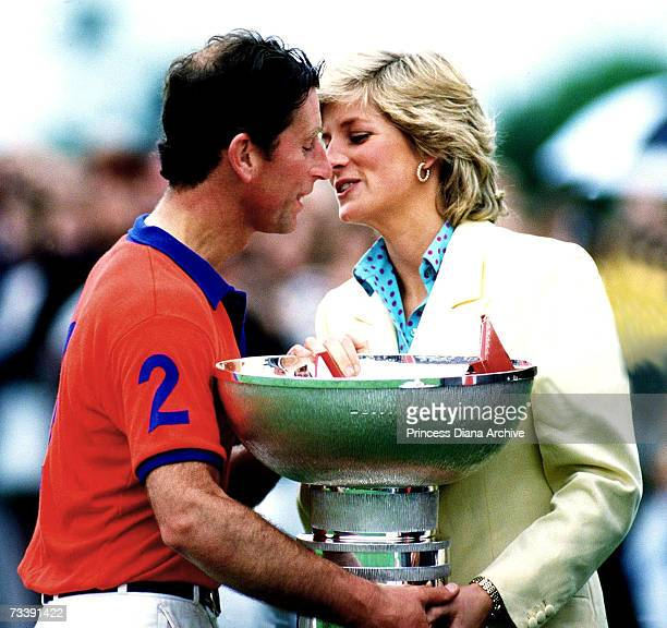 The Princess of Wales presenting her husband with a large cup at the Constantine Cup Polo match May 1987