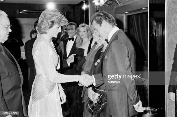 The Princess of Wales Princess Diana greets lead actor Roger Moore at The Royal Premiere of the 14th 007 James Bond Movie 'A View To A Kill' at the...