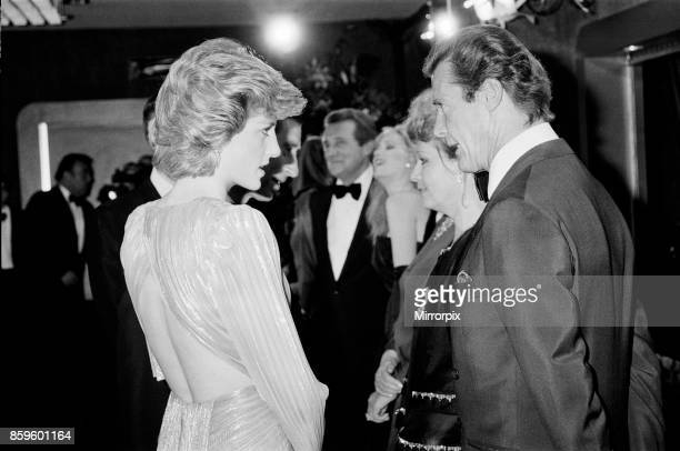 The Princess of Wales Princess Diana talking with lead actor Roger Moore at The Royal Premiere of the 14th 007 James Bond Movie 'A View To A Kill' at...
