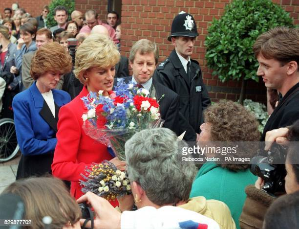 The Princess of Wales receives a bouquet of flowers from wellwishers who had turned out to see her at the London Lighthouse a residential and support...