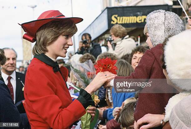 The Princess Of Wales Recieving A Bunch Of Flowers From A Little Girl In The Crowd During A Walkabout In Wales