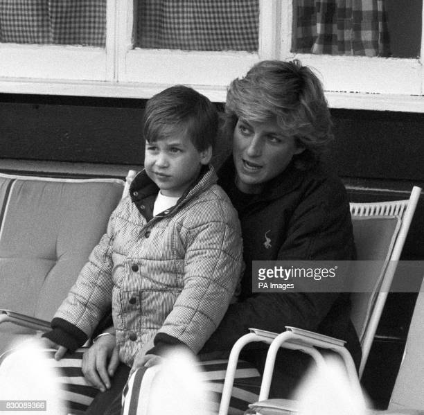 The Princess of Wales sits with her four year old son Prince William on her lap watching the Prince of Wales play polo at Smith's Lawn Windsor